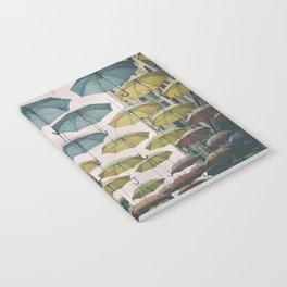 Umbrellas in the sky Notebook