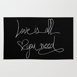 Love is all you need white hand lettering on black Rug