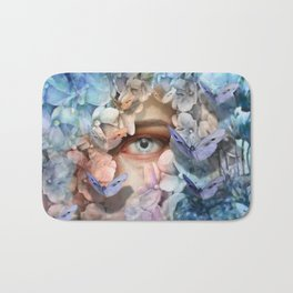 """Waiting for spring among blue flowers"" Bath Mat"