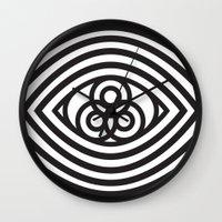 third eye Wall Clocks featuring Third Eye by cmyka