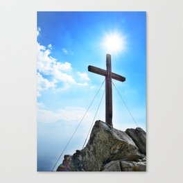 Wooden cross on peak Canvas Print