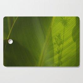 Green plant with shadow Cutting Board