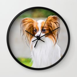 Portrait of a papillon purebreed dog with grass behind Wall Clock