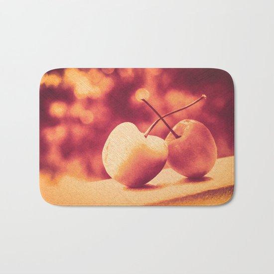 Sweet Moment (Rainier Cherries with Gold & Wine Red Bokeh Background) Bath Mat