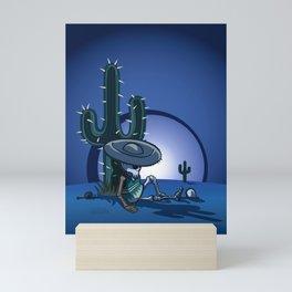 Cactus and skeleton at night in the desert Mini Art Print