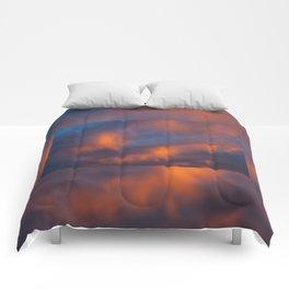 orange light on cirrus clouds and blue sky Comforters