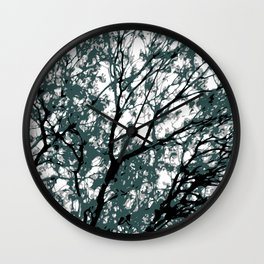 tree branch with green leaves abstract background Wall Clock