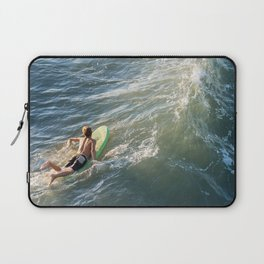 Surfer paddles out on surfboard without a wetsuit Laptop Sleeve