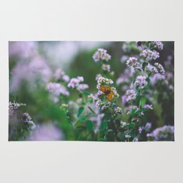 Butterfly in the flowers Rug