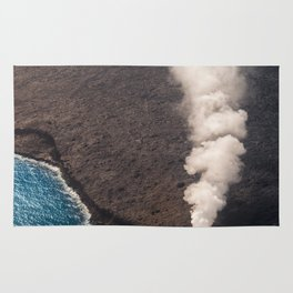 Kamukona molten hot lava stream sprouting into the Pacific Ocean in Hawaii Rug