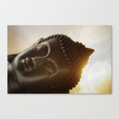 The silhouette of a Buddha head in Sunrise Canvas Print