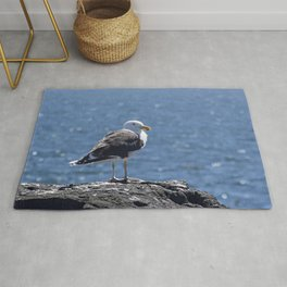 Seagull overlooking the ocean Rug