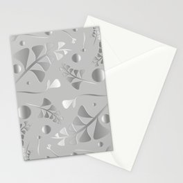 Vector pattern from silver black plants and grass blades on a gray background in vintage style. For Stationery Cards