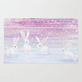 bunnies frolic in the snow Rug