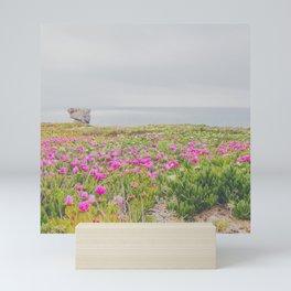 Flowers over the ocean Mini Art Print
