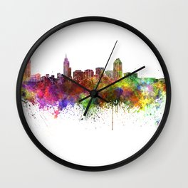 Raleigh skyline in watercolor background Wall Clock