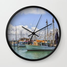 Boats moored on a river Wall Clock