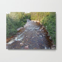 Iron rich river flows from high mountain Metal Print