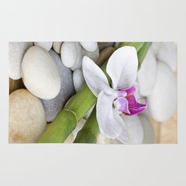 white Orchid flower  and green Bamboo still life Rug