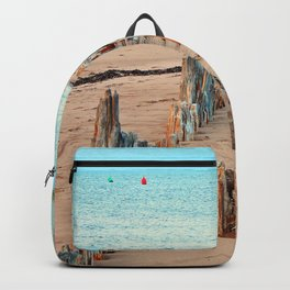 Wharf Remains on the Beach Backpack