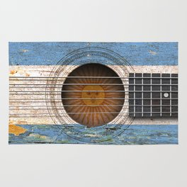 Old Vintage Acoustic Guitar with Argentine Flag Rug