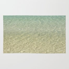Crystal clear turquoise shaded waters of a sandy beach Rug