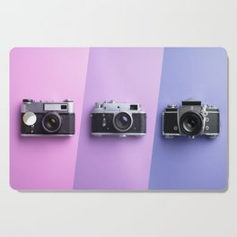 Multiple vintage cameras Cutting Board