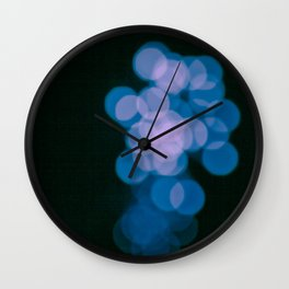 Teal blue bokeh lights, abstract unique pattern, black background Wall Clock