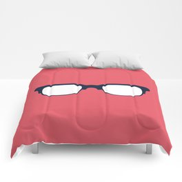 Sun Glasses on Red Comforters