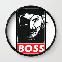 metal gear solid Wall Clocks featuring Big Boss - Metal Gear Solid by TxzDesign