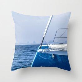 A Catamaran Edge Sleeps in the Ocean Blue Throw Pillow