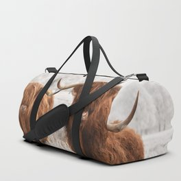 Hairy Scottish highlanders in a natural winter landscape. Duffle Bag