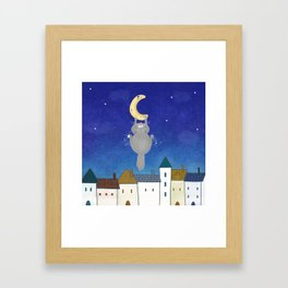 Cat and town Framed Art Print