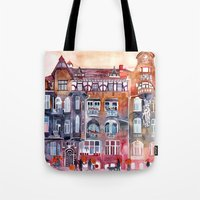 takmaj Tote Bags featuring Apartment House in Poznan and orange umbrellas by takmaj