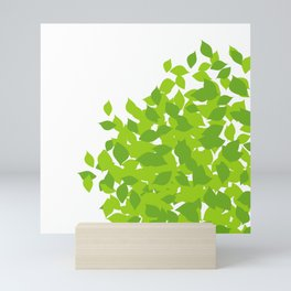 Composition with fresh green spring leaves- earth day gift Mini Art Print