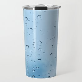 Drops of water on a glass, on a blue background Travel Mug