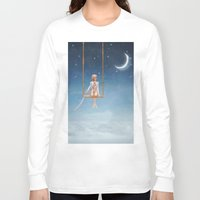 toddler Long Sleeve T-shirts featuring The lovely girl shakes on a swing by natalia.maroz