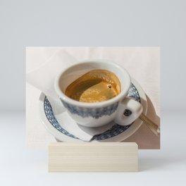 Italian espresso coffe with cream on a table outside a bar in Italy. Mini Art Print