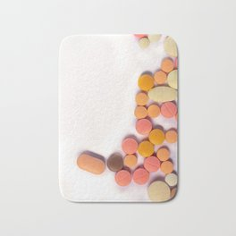 Numerous colorful pills on white background. Bath Mat