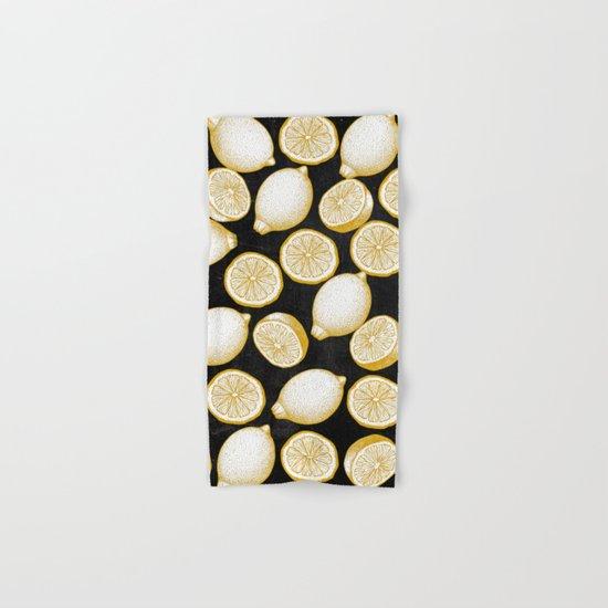 Lemons on black background  Hand & Bath Towel