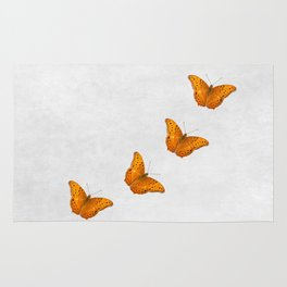 Beautiful butterflies on a textured white background Rug