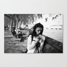 windswept girl by the thames Canvas Print