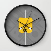 jake Wall Clocks featuring Marshmallow Jake by Oblivion Creative