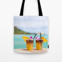 Mai tais drinks on Waikiki beach in Honolulu, Hawaii. Tote Bag