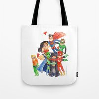 justice league Tote Bags featuring Justice League Hug! by Super Group Hugs