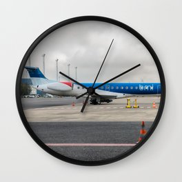 The plane at the airport Wall Clock