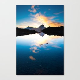 Bietschorn mountain peak at sunrise reflecting in small lake Canvas Print