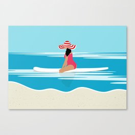 Solo surfing woman Canvas Print