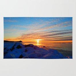 Sun sets on frozen land Rug