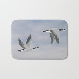 Canada geese and blue sky Bath Mat